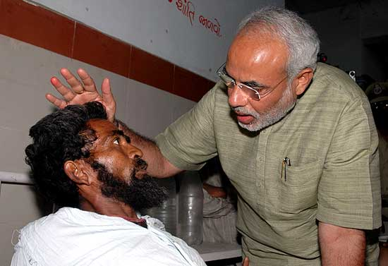 The scare in the eyes of this 'victim' tells all. It's one of those rarest photos of Modi who visited Civil Hospital, Ahmedabad at the instance of Advani, post-Godhra pogrom.